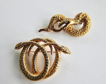 Two Rhinestone Snake Brooches