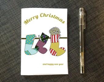 Biglietto di auguri stampabile di Buon Natale con calze appese - DOWNLOAD ISTANTANEO-A6