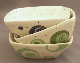 Square bowls with circle designs. Handmade by Sara Hunter Designs