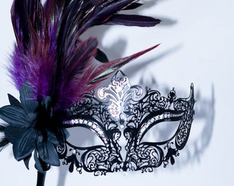 masquerade mask, masquerade mask with a stick and  purple feathers, laser cut metal mask black and white crystals