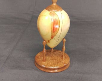 Spalted flame box elder hollow form with sapele base and finial