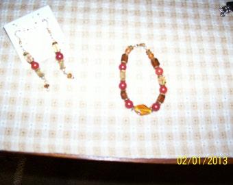 Bracelet & earrings, red, browns, yellows