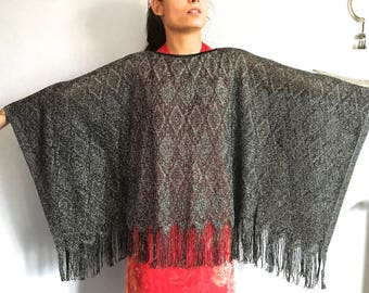 vintage poncho lurex fringed poncho metallic knit poncho black silver jacquard weave metallic cape vintage black fringe vtg poncho boat neck