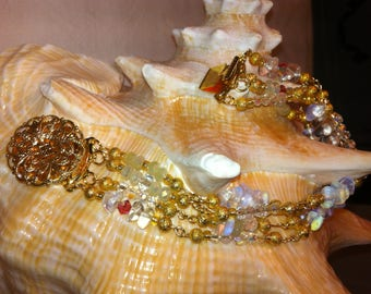 Bracelet composed of crystals and opalines embellished with some pink bicones