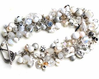 whispers of white. bracelet. wire wrapped bracelet. white beaded wrap bracelet. swarovski. moonstone. pearls. sterling silver clasp.