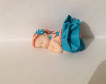 Polymer clay with turquoise and coral dress baby