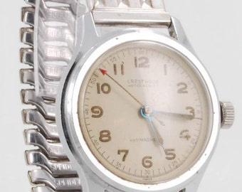 Crestwood vintage wrist watch, 15 Jewels, stainless steel water resistant case, silver-toned & stainless steel expansion band