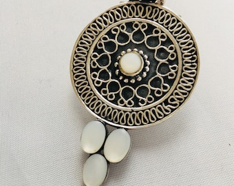 Silver and mother of Pearl pendant.