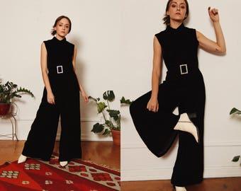 Vintage 1960s Black Velvet Wide Leg Sleeveless Jumpsuit Pant Suit with Mock Neck and Rhinestone Belt Buckle size Small Medium