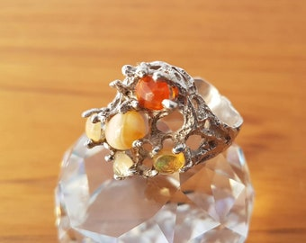 Sterling silver brutalist 1970s ring set with semi-precious stones.