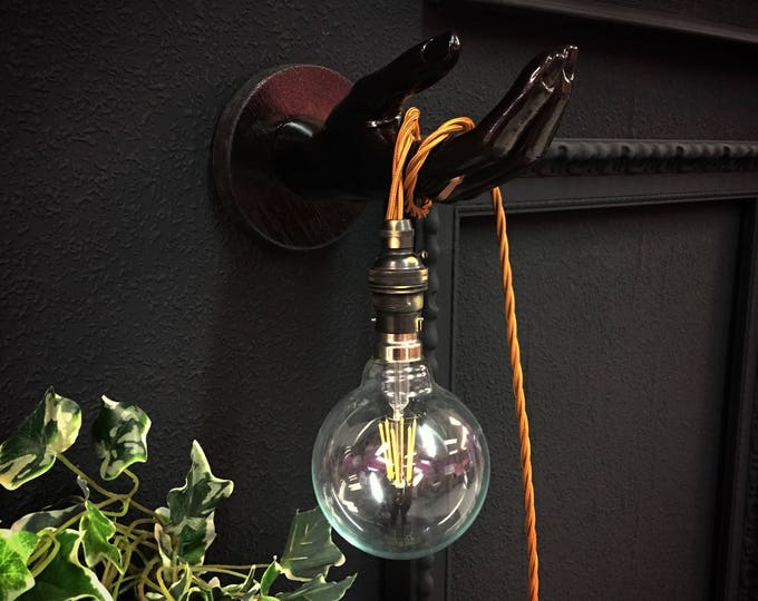 Upcycled mannequin hand wall lights