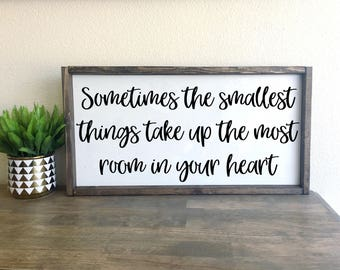 Sometimes the smallest things take up the most room in your heart   framed wood sign