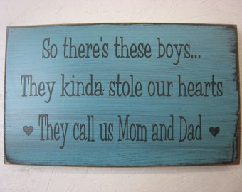So there are these boys...They kinda stole our hearts... They call us Mom and Dad. With Two hearts. Rustic Sign for parents.