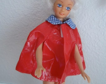 Barbie Doll Style Red Plastic Cape with gingham fabric collar ready for spring rain