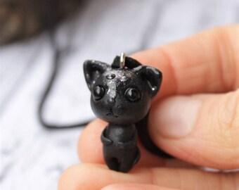 The tiny black kitten, star kitten, cute tiny cat holiday giftrs 2017