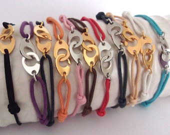 Bracelet style handcuff with various colored cord