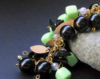 Spring Green Charm Bracelet Beaded in Vintage Beads, Black Glass and Gold - Triumphant. Handmade Jewelry by Gilliauna