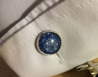 A pair of blue geometric patterned cufflinks