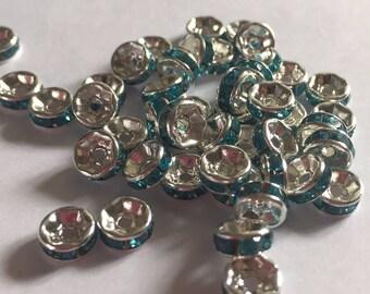 Set of 10 Grade A aqua rhinestone spacer beads.