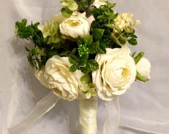 Angel wings bouquet with matching boutonniere