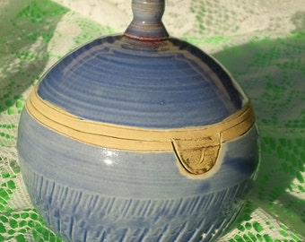 A 4 inch by 4 inch 'Wish' Box - Stoneware thrown in one piece and altered. Pooled glazes  inside. One of a kind.