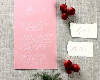 Elegant calligraphy wedding menus on dusky pink textured paper