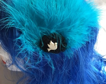 Teal feather fascinator with black lace and cream dove trim on crocodile clip