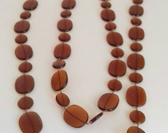 Vintage necklace with flat brown plastic beads.