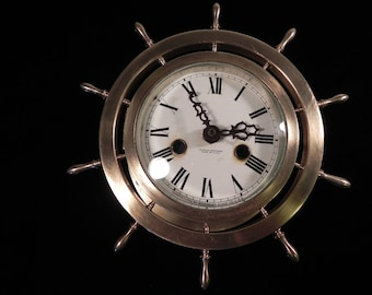 ships wheel wall clock, solid brass,  convex beveled glass