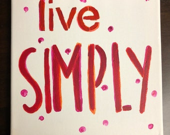"Canvas painting ""live simply"""