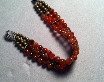 Triple Strand Carnelian Bracelet.