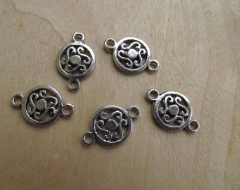 Set of 4 round connectors filigree 19 x 12 x 2 mm silver tone antiqued.