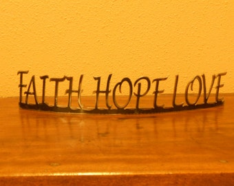 Faith Hope Love metal rolled word