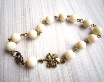Clara Vintage Orchid Flower Bracelet in White Coral and Brass
