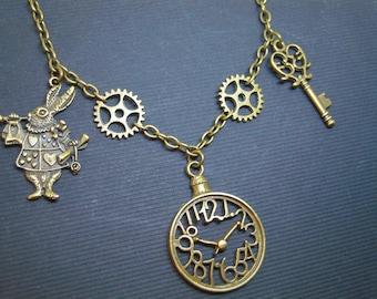 Necklace alice in Wonderland rabbit trumpet, clock, key, gears steampunk Ref: 528