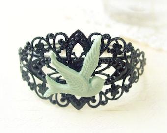 ON SALE  Black Filigree Cuff with Mint Green Swallow
