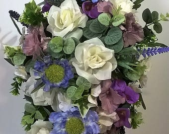 Summer bridal teardrop bouquet in this year's colour-range of blue and lilac. featured flowers include pastel scabius and lilac hydrangea