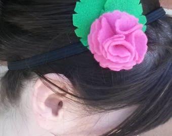 pink felt flower with green felt leaves on elastic headband