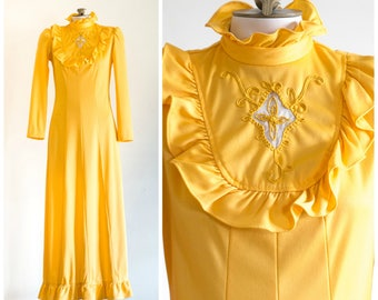 1970s yellow maxi dress with high neck and ruffled skirt