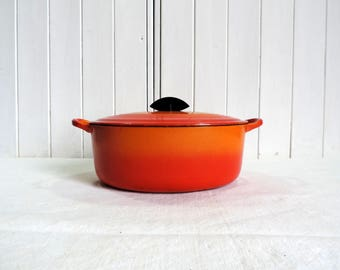Le Creuset size D casserole or Dutch oven in retro orange changing to red at the base