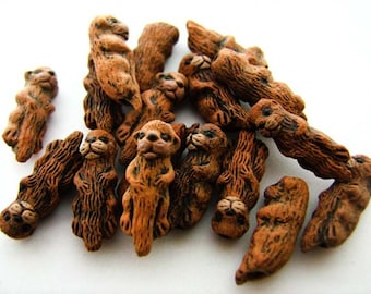 10 Tiny Otter Beads