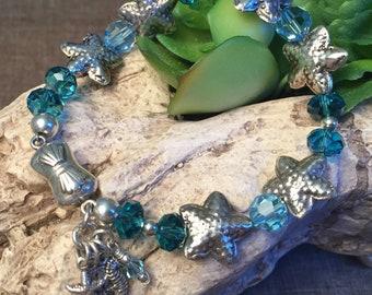 SEA TREASURE, artisan sterling silver and Swarovski crystal bracelet