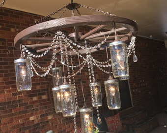 Wagon wheel chandelier etsy large wagon wheel chandelier with 3 tiers of mason jars lights mozeypictures Choice Image