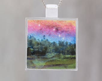 Dancing Sky  - Glow-in-the-dark pendant with a surreal image of trees