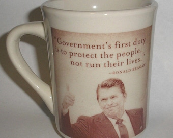 Cool Ronald Reagan Thumb's Up Government duty to protect people republican Mug