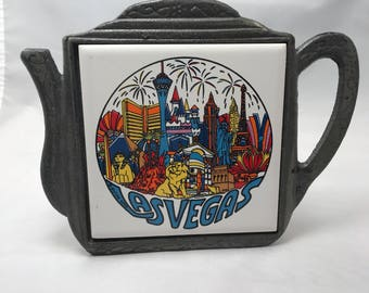 Vintage 60s Las Vegas trivet metal and ceramic