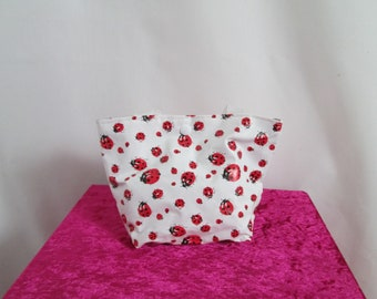 Mini tote bag in white oilcloth with red and black ladybugs