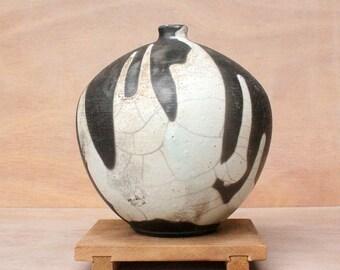 Black raku vase with white slip
