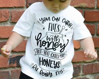 You Can Catch Flies With Honey But You Can Catch More Honeys By Being Fly Kid's Trendy Tee Or Bodysuit Baby Toddler Boy Girl Clothing