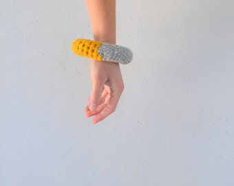 Large woolen bangle bracelet in grey and mustard yellow, modern crochet jewelry - neo tribal